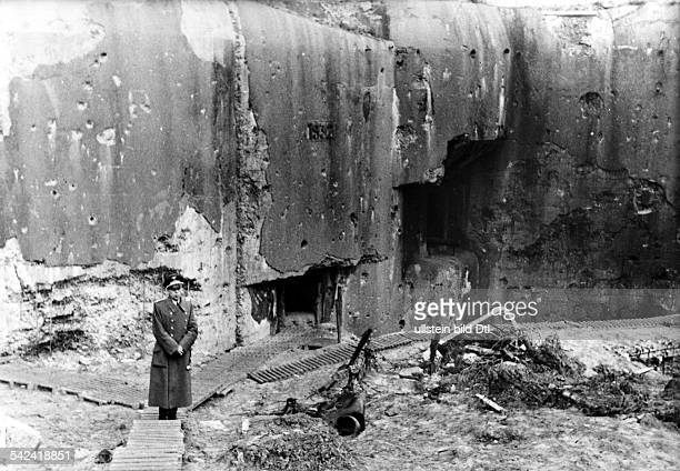 World War II Campaign against France officer of the Wehrmacht next to destroyed defence works at the Maginot Line Photographer Paul Mai 1940Vintage...
