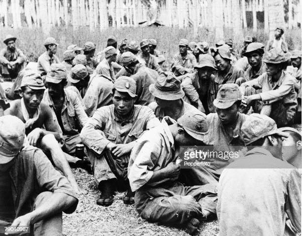 World War II, circa 1942, Japanese soldiers look dispirited as they become prisoners of the Americans after fierce fighting on the island of...
