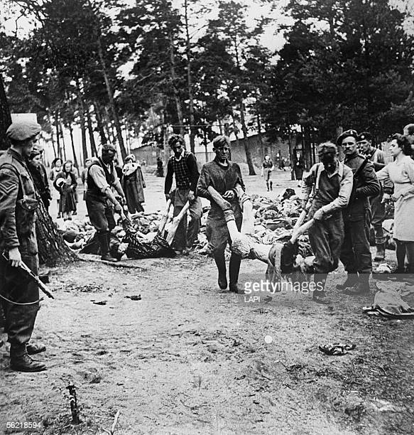 World War II Concentration camp of BergenBelsen SS carrying the corpses under Allies surveillance