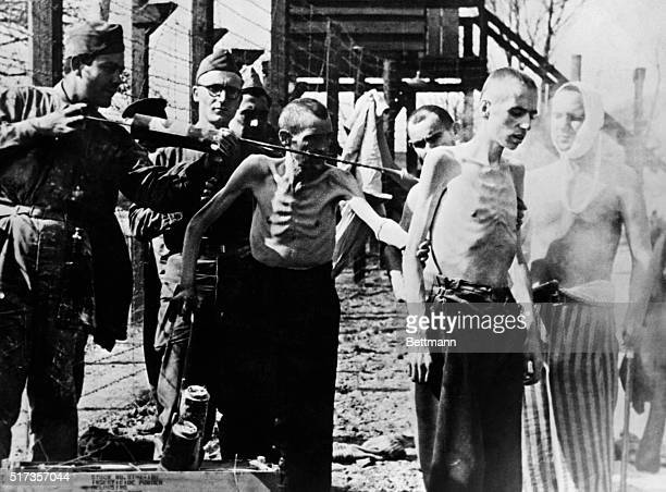 World War II concentration camps Two former inmates of Mittelgladblach Camp being sprayed by allied soldiers against communicable diseases Undated...