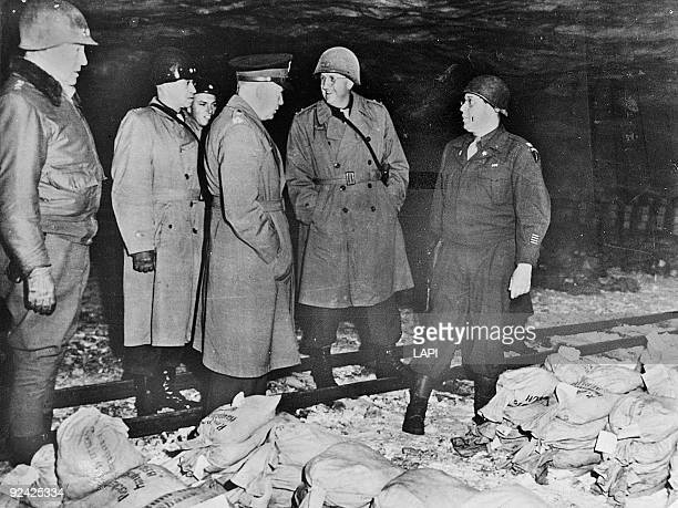 World War II. Discovery of gold, money and valuables, stored by the Germans in iron mines, in the presence of Generals Eisenhower, Bradley, Mantan,...