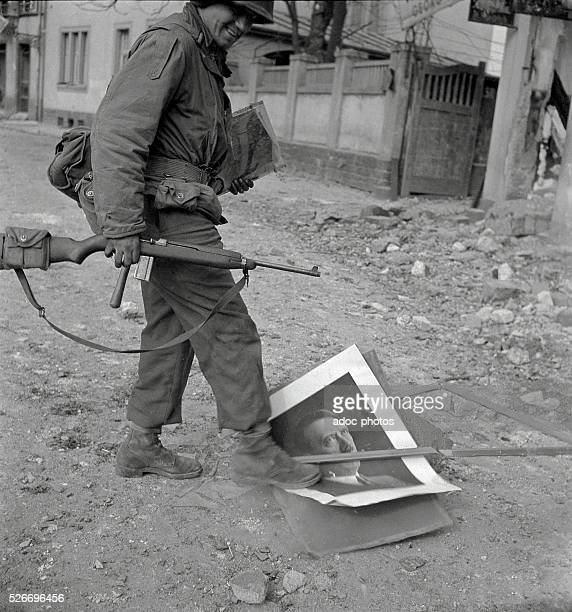 World War II During the advance of the Third United States Army in Germany Soldier trampling a portrait of Hitler In 1945