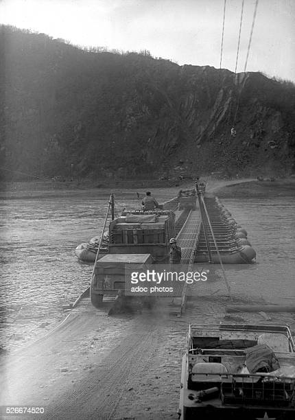 World War II. During the advance of the Third US Army in Germany. Crossing a river using a pontoon bridge. In 1945.