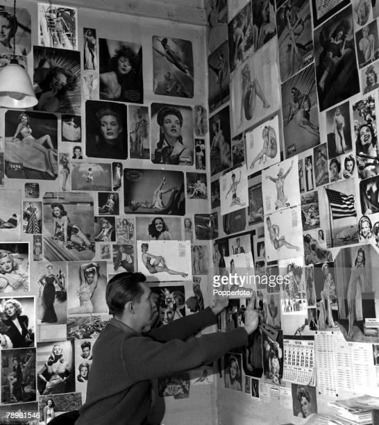 World War II England April 1944 USAAF Mustang Fighter Station of Ace Pilots A section of the PinUp girl collection in one of the dispersal huts of a...