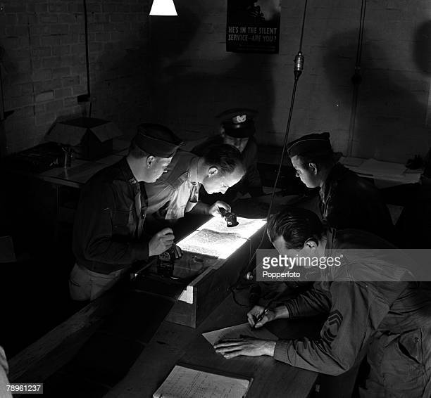 World War II England USA's Photographic Reconnaissance Unit are pictured studying a photograph