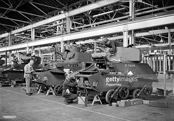 World War II England Workmen refitting and repairing tanks in a factory somewhere in Southern England The tanks were bought back from Dunkirk for...
