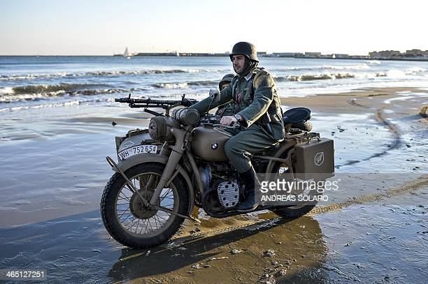 A World War II enthusiast drives a sidecar as he takes part in a reenactment to mark the 70th anniversary of the Allied landings on Anzio beach 52 km...