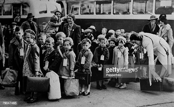 circa 1940 Small children with their suitcases and belongings ready to they leave the city for the relative safety of the countryside