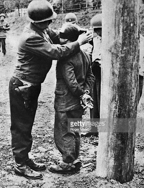 World War II Execution of a German by allied soldiers who blindfolds him 1945
