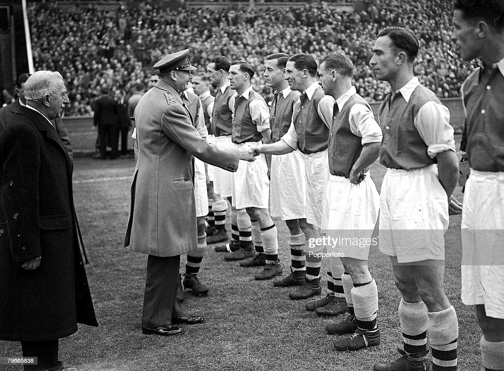 World War II, Football, 1st May 1943, The Duke of Gloucester shakes hands with Arsenal+s Ted Drake prior to the football league south cup final at Wembley between Arsenal and Charlton, Arsenal won the match 7-1 : News Photo