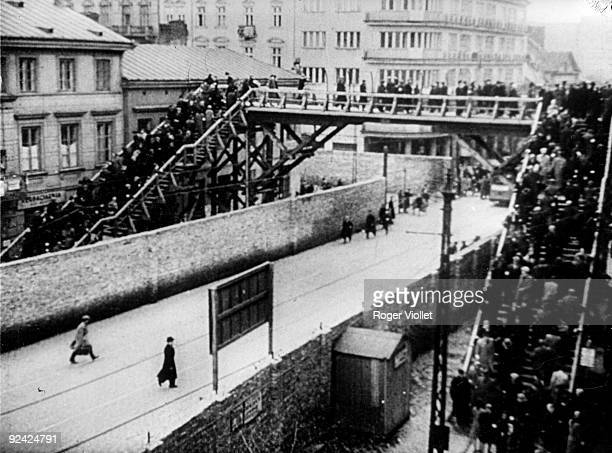 "World War II. Footbridge for the Jews connecting the ""Small Ghetto"" to the ""Large Ghetto"", over the Chlodna street, reserved for the Aryans. Warsaw,..."