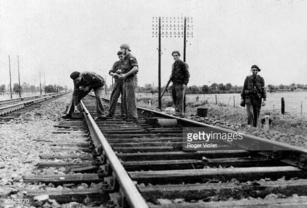 World War II French Resistance fighters sabotaging a railway in SaôneetLoire AugustSeptember 1944