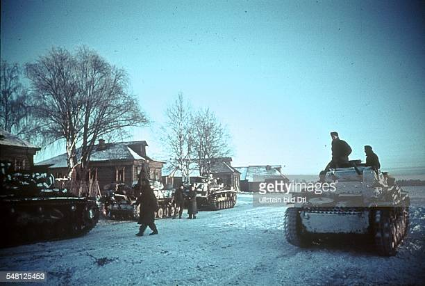 World War II German camouflage tanks in a Russian village near Moscow November 1941 Photographer Artur Grimm