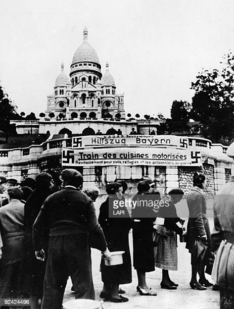 World War II German field kitchens distributing food to the refugees of Montmartre Paris end of August 1940