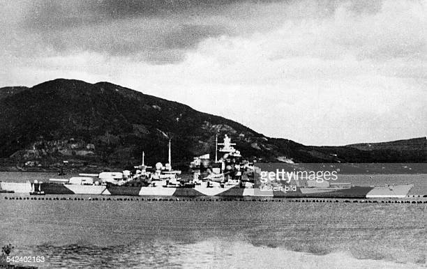 World War II German Kriegsmarine Battleship TIRPITZ behind torpedo protective nets in the Bogen bay of the Ofotfjord in Norway near Narvik 1944