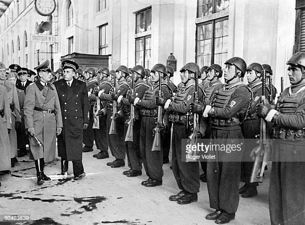 World War II German Marshal von Rundstedt and Italian Admiral Vittorio Tür reviewing an Italian detachment at the Toulon train station 19431944