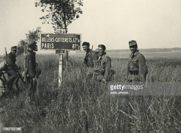 German soldiers on National Highway 2 to Paris, between Soissons and Villers-Cotterets . On June 9th, 1940.