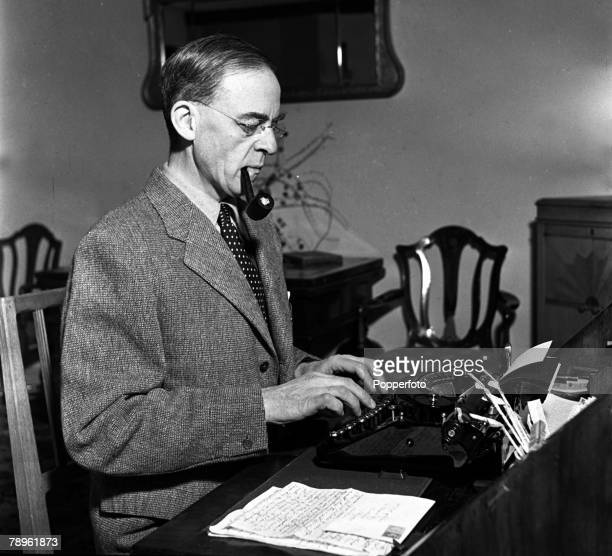 World War II Gloucestershire England Sir Stafford Cripps is pictured working at his typewriter in his office Cripps was a Labour politician...