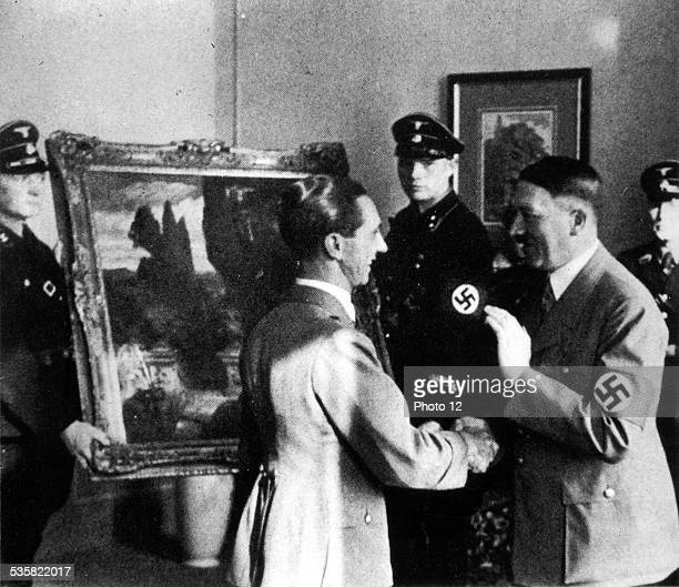 World War II Hitler and Goering looking at works of art stolen from the Italians