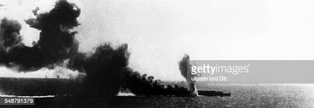 World War II in the Pacific Battle of Midway Japanese aircraft carrier that is already burning getting another blow around June 5/6 1942 Vintage...