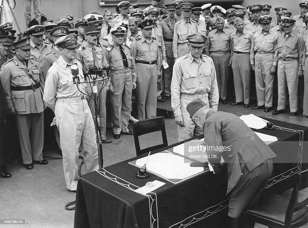World War II in the Pacific Japanese Surrender aboard the USS Missouri in Tokyo Bay, September 2, 1945; General Yoshijiro Umezo is signing the surrender document for the Imperial Japanese Army - : News Photo