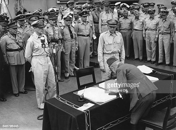 World War II in the Pacific Japanese Surrender aboard the USS Missouri in Tokyo Bay September 2 1945 General Yoshijiro Umezo is signing the surrender...