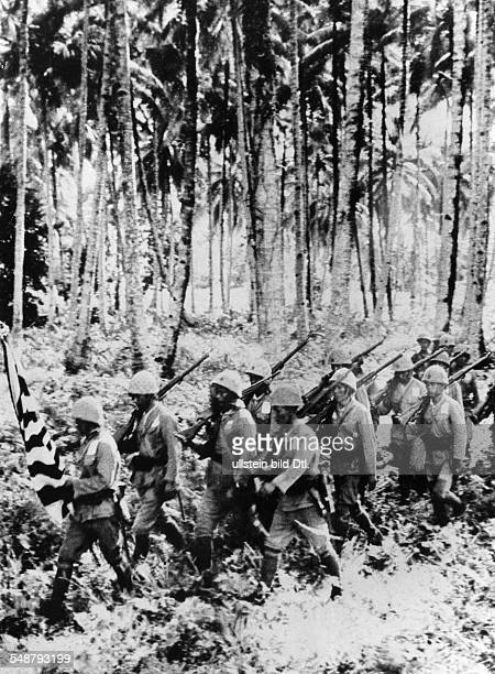 World War II in the Pacific - the Battle of Guadalcanal Japanese infantry unit marching through a palm grove - 1943 - Vintage property of ullstein...