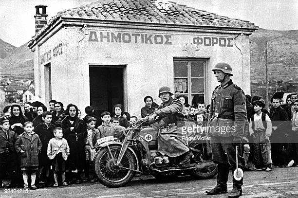 World War II. Invasion of Greece by the German army. Greek civilians looking at the Germany army making its way to Salonica, on April 9, 1941.
