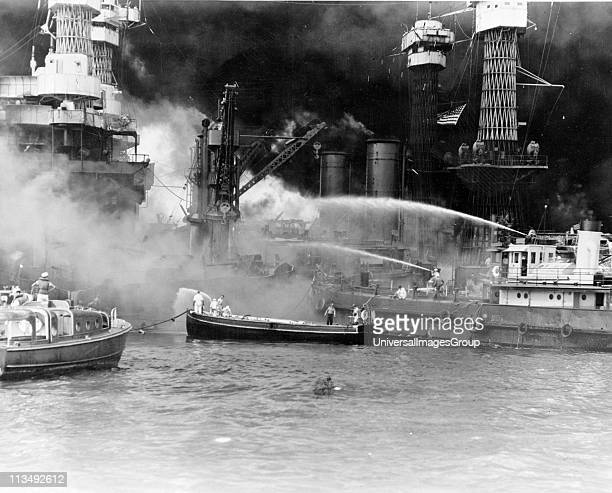 World War II Japanese attack on United States naval base at Pearl Harbour Hawaii 7 December 1941 Battleship USS West Virginia in flames after hits...