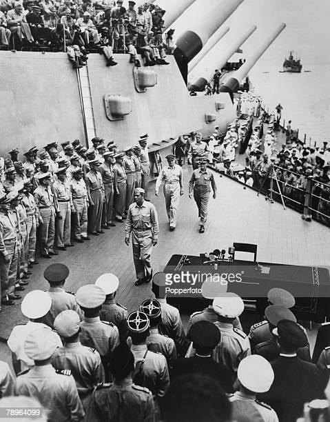 World War II Japanese Surrender Tokyo Bay 2nd September 1945 General Douglas MacArthur strides across the deck of the 'USS Missouri' to accept the...
