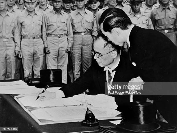 World War II, Japanese Surrender, Tokyo Bay, 2nd September 1945, Japanese Foreign Minister Mamoru Shigemitsu signs the surrender document on the USS...