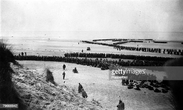 World War II June 1940 Dunkirk France This picture shows the evacuation of Dunkirk as British troops on a beach form into long winding queues ready...