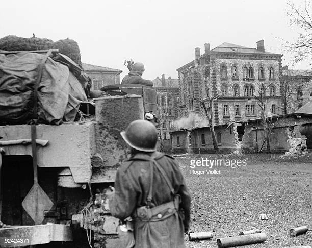 World War II Liberation of Alsace French tank shooting on the Lefebvre barracks headquarters of the Gestapo and also the Germans' last place of...