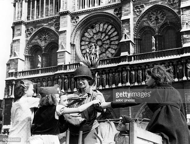 World War II Liberation of Paris Distribution of chewing gum to children in Paris by American soldier In August 1944