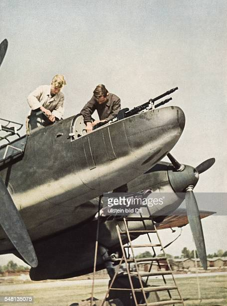 World War II Loading a Me 110 of the German air force with ammunition and machine guns 1943 Published by 'Signal' 8/1943 Vintage property of ullstein...
