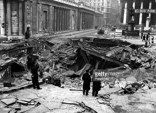 World War II London England Workers and bystanders observe the extensive bomb damage caused by German bombing raids outside the Bank of England