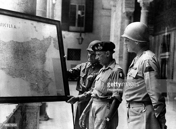 World War II MajorGeneral Geoffrey Keyes General Sir Bernard Montgomery and LieutenantGeneral George S Patton studying a map of Sicily at the Royal...