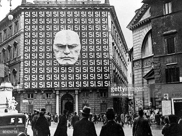 World War II Mask of Mussolini on the facade of a building