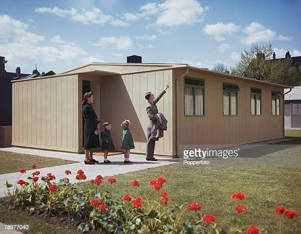 World War II May 1944 Exserviceman Leonard Hickman and family visit a Churchill all steel house for a viewing
