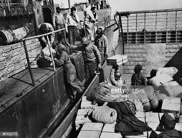 World War II Normandy landings American soldiers loading a landing craft in an English port