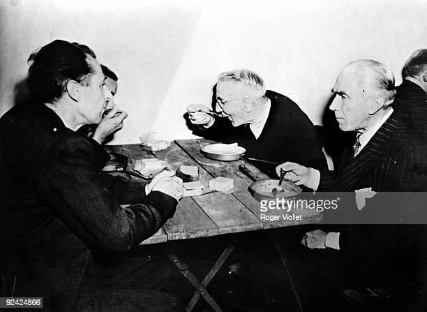 World War II Nuremberg trials Fritzsche Schacht and von Papen lunching in their prison