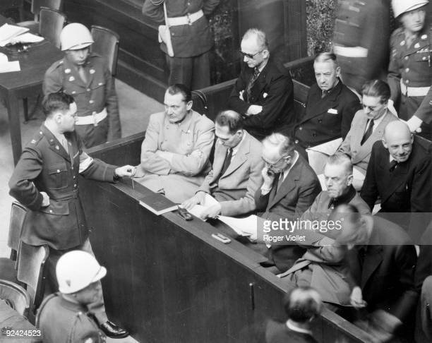 World War II Nuremberg trials Goering questioned by American Captain G M Gilbert jail psychologist Next to Goering Rudolf Hess Ribbentrop Keitel and...