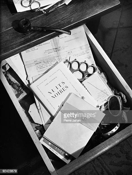 World War II Occupation Drawer of a desk holding a copy of Steinbeck's book 'Black nights' and a knuckleduster Paris June 1944