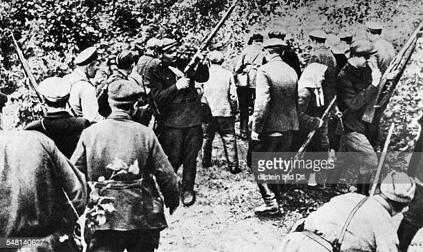 World War II Operation Barbarossa handing out weapons to partisans after the German attack on the Soviet Union on June 22 1941 August 1941 Vintage...