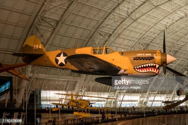 World War II P-40 fighter hangs in the Udvar-Hazy Air and Space Museum, Virginia.