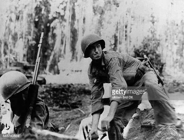 World War II Pacific battle of Guadalcanal USsoldier with a hand grenade 1942