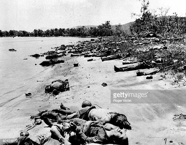 World War II. Pacific front. Japanese corpses on the beach of Saipan .