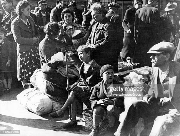 World War II Paris July 1940 Belgian refugee families waiting at the Gare du Nord to be repatriated By this time Paris was under German occupation