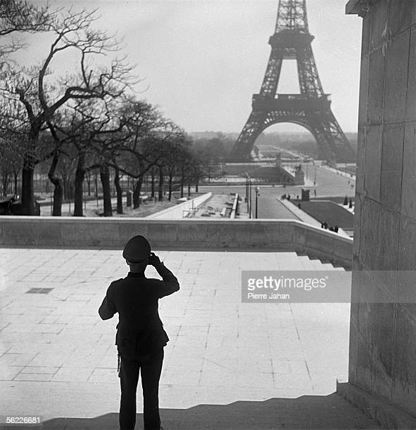 World War II Paris under the Occupation German officer admiring the Eiffel tower at the Chaillot palace