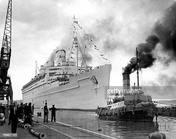 circa 1942 The transatlantic ocean liner Queen Mary about to berth when she was being used as a troopship during World War II